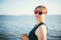 Anastasia (Andreychenko) Tags: sea portrait water girl portraits canon 50mm glasses pretty dof bokeh 14 smooth petersburg anastasia russian depth silky fd