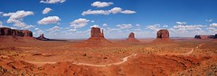Monument Valley Panorama (d.dk) Tags: road blue red sky panorama cloud sun monument nature car rock landscape utah valley monumentvalley gravel