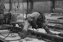 Welder (andreariso) Tags: street rails blacknwhite hardwork welder solderind