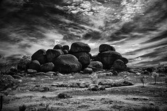 The rock that doesn't roll. (erglis_m (Mick)) Tags: contrast canon landscape ir interesting nt canoneos20d infrared outback australianlandscape eos20d northernterritory outbackaustralia purnululu theoutback centraldesert tanami thedevilsmarbles tanamidesert