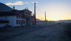 The entrance gate of Sershul Monastery at daybreak, Tibet 2014 (reurinkjan) Tags: 2014 southentrance easterntibet བོད་ལྗོངས། ©janreurink amdoཨ༌མདོ tibetanplateauབོད་མཐོ་སྒང་bötogang tibetབོད sershulསེར་ཤུལ།county sershultekchendargyelingསེར་ཤུལ་ཏེཀ་ཆེན་དར་གྱེ་གླིང་ gelukpayellowhatsectདགེ་ལུགས་པdgelugspa gelugpaschoolརི་བོ་དགའ་ལྡན་ribodgaldanriwoganden sunriseཉི་ཤར།nyishar sunisrisingཉི་མ་འཆརnyimanchar khamཁམས་བོད ༢༠༡༤ sershülgönསེར་ཤུལ་དགོན། dawndaybreakནམ་ལངས་namlangs