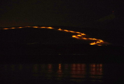 streetlights on a zig-zag road across the bay
