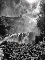 Marmore's waterfalls (iPhone shot) (Sconsiderato) Tags: sunset bw italy sun white black apple nature water sunshine photoshop photo blackwhite italia phone natural photos cell cellular natura it falls waterfalls sole acqua riflessi bianco nero biancoenero bellezza iphone riflesso cascate cascata modifiche mywinners photonature sconsiderato