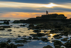 A Couple on the Rocks (tquist24) Tags: california heislerpark lagunabeach nikon nikond5300 pacificocean people beach clouds couple evening geotagged ocean reflection reflections rocks seascape silhouette sky sunset tidepools water unitedstates