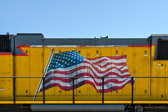 old glory. barstow, ca. 2014. (eyetwist) Tags: california railroad west color up yellow america train photoshop stars nikon desert diesel stripes flag transport patriotic american highdesert mojave infrastructure unionpacific americana locomotive nik nikkor 4thofjuly independenceday railyard processed arid typology mojavedesert oldglory barstow uprr emd cs6 sd70m eyetwist nikcolorefex efex buildingamerica d7000 eyetwistkevinballuff nikond7000 18200mmf3556gvrii
