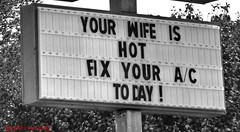 Suburban Wit and Wisdom (Halcon122) Tags: bw usa hot virginia highway humorous ad billboard wife suburb northern