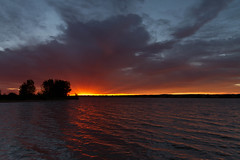 Sunrise Rays (mclcbooks) Tags: morning red sky orange lake clouds sunrise landscape dawn colorado denver chatfieldstatepark lakechatfield