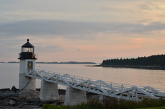 Marshall Point Lighthouse (~Maninas) Tags: ocean travel light sunset sea summer usa lighthouse white seascape me water architecture america outside outdoors coast nikon colours maine scenic newengland august landmark icon atlantic east coastal walkway maritime northeast tranquil eastcoast 2014 portclyde thestates explored maninas marshallpointlighthouse mainelandscape stgeorgepeninsula d5100 maineseascape august2014