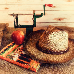 An Apple, a Hat, and a Book (Explored) (lclower19) Tags: takeaim apple hat book cook peeler pioneerwoman burlap reedrummond explored stilllife