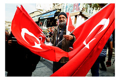 An elderly man sells Turkish flags at Grand Bazaar, Istanbul (Roman Lunin) Tags: turkey elderly flag vendor market grandbazaar istanbul street streetphotography streetphoto strangers walkby urban city peopleincity
