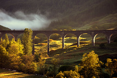 Dawn sunlight and mist at Glenfinnan Viaduct (iancowe) Tags: morning bridge cloud sunlight mist train sunrise concrete dawn scotland arch harry potter harrypotter scottish rail railway arches line viaduct valley glenfinnan fortwilliam mallaig glenfinnanviaduct