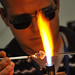 A glassblower works his magic at Maker Faire.