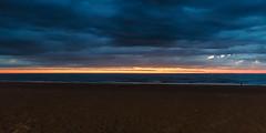 Oostende Beach at Dusk (Dennis Bevers) Tags: sea beach clouds evening blurry belgium dusk horizon be oostende bacheloretteparty flanders westflanders