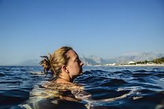 Marta (Melissa Maples) Tags: blue sea summer woman mountains beach water turkey nikon asia mediterranean trkiye canadian antalya marta nikkor vr afs  18200mm  f3556g  18200mmf3556g d5100 konyaaltbeach