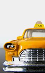 Mini Taxi (Arivan Miculis Reigota) Tags: ny newyork macro yellow closeup canon toy taxi yellowcab amarelo novayork flickrfriday newyorke novayorke sx510