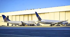 United Airlines 747 replacement 777-300er. 747 N128UA and 777 N2333U at San Francisco Airport. 2017. (planepics43) Tags: unitedairlines n2333u n2331u n2332u 777300 n128ua sfo sanfranciscoairport airport california 777 maintenance claytoneddy 17crossfeed landing boeing weather winglet 320 787 747 737 757 767 380 319 engine 350 lufthansa pilot flightattendant