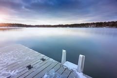 Sisjön (Geoffrey Gilson) Tags: waterscape jetty badet sisjon sweden goteborg winter cold sunset snow ice white blue violet