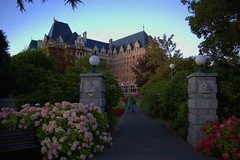 Corner Gate to the Empress (kfopsen) Tags: lighting flowers plant canada architecture gate britishcolumbia victoria vancouverisland theempresshotel