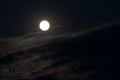 Super Moon shining down clouds (ale_brando) Tags: sunset moon clouds it september fullmoon moonlight fx 08 80400mm 2014 d700 nikonfx supermoon superluna