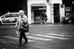 straight in the eye (White_V) Tags: road street old city woman paris car shop canon walking crossing expression streetphotography wb elderly 2014 whiteandblack bildings