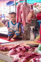Hangout (Universal Stopping Point) Tags: street toddler cambodia sihanoukville child market meat butcher