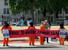 Free Shaker Aamer now (Andy Worthington) Tags: london westminster squares politics protest streetphotography parliament parliamentsquare banners jumpsuits guantanamo placards sw1 hoods londonsquares politicalprotest andyworthington orangejumpsuits londonsw1 closeguantanamo boroughofwestminster shakeraamer saveshakeraamercampaign saveshakeraamer