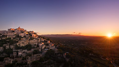 Gordes Purple Sunrise (Philipp Klinger Photography) Tags: morning blue trees light red sky panorama orange sun france tree nature field yellow sunrise landscape town nikon frankreich purple angle wine hill wide illumination valley fields sunburst provence luberon gordes philipp hilltop cpl d800 klinger