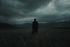 Leaving the plains (Alessio Albi) Tags: portrait cloud nature field self dark mood dramatic atmosphere drama