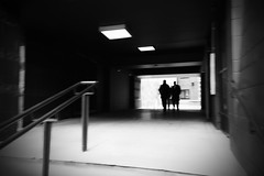 Two of each (Andrew.King) Tags: street photography blackandwhite monochrome contrast vanighing point bannister pavement light wall ceiling steps stairs people movement shadows highlights