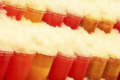 ice juice. (maotaola) Tags: iceday smileonsunday icejuice inarow diagonal hielo jugosenhielo coloredshot bermellón vermilion rhythm patterns mercadodelaboquería cmwdred warmcolors