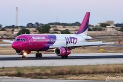 WizzAir --- Airbus A320 --- HA-LWF (Drinu C) Tags: plane aircraft sony airbus panning dsc a320 wizzair mla lmml hx100v halwf adrianciliaphotography