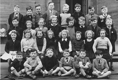 Class Photo (theirhistory) Tags: uk school girls boys playground socks children outdoors photo shoes group tie class badge bow junior gb zipper jumper shorts form blazer primary cardigan pupils wellingtons