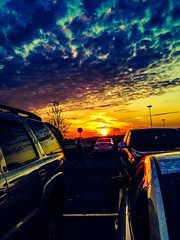 crazy sunset (ashlyn.maria) Tags: camera blue trees light sunset red sky orange cloud sun hot cars car yellow clouds photography cool rainbow shine purple 5 parking lot iphone 5s