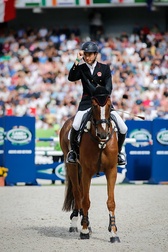Alex and Harbour Pilot C salute the judges at the World Equestrian Games 2014 Photo Xia Yuanpu