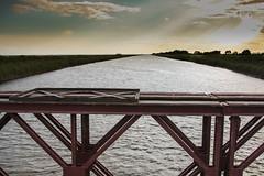 Lungo il delta del P, Comacchio, Ferrara, Emilia Romagna (william eos) Tags: tramonto fiume ponte canali vallidicomacchio deltadelp williamprandi