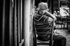 sitting on life (MarioMancuso) Tags: life road street old city people urban blackandwhite italy white man black monochrome photography mono photo noir sitting fuji streetphotography documentary scene naples fujifilm streetphoto blanc reportage monocrome 2014 x100s