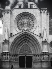 Tarragona Cathedral - Tarragona, Spain (Brent Betz) Tags: sky blackandwhite sculpture bird church statue clouds walking person coast spain europe doors cathedral spires basilica gothic saints arches stainedglass holy tarragona catholicguilt