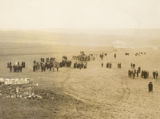 Army band and people in a field