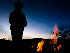 Evening Texas Campfire (DevilnBaggyPants) Tags: texas night rancher cowboy hat fire campfire sunset silhouette flames camp country evening
