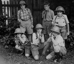 Ready for battle (theirhistory) Tags: trees boys hat shirt fence children army belt boots rifle helmet tie shorts wellies scoutuniform earthplants