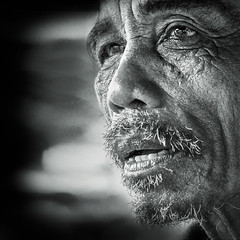 No one knows what it's like (Rob Castro) Tags: portrait blackandwhite bw man monochrome vertical closeup square asian philippines naturallight oldman pensive facialhair farmer grainy wrinkles deepthoughts xpressus thedefiningtouch juznobsrvr justanobserver juzno iamgenerationimage