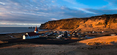 Vik (Iceland) Panorama (baddoguy) Tags: city light sea panorama mountain church sunrise golden town iceland village cloudy images vik getty