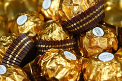 Ferrero Rocher (WorldClick) Tags: food canon photography eos gold photo milk yummy flickr photographer basket chocolate tag treats nuts almond vivid wrap tasty cadbury divine delicious eat coco photograph almonds ribbon treat capture crunch wrapper hazelnut crunchie ferrerorocher phototgraphy 1100d canoneos1100d worldclick