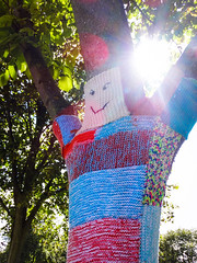 Hands up if you are a Happy Tree! (Fleety Vision) Tags: sunlight tree leaves sunshine port happy knitting yarn smiley patchwork bombing wirral