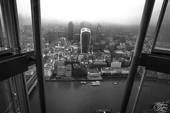 View from the Shard (Umbreen Hafeez) Tags: city uk bridge england bw white mist black building london tower misty fog thames architecture buildings river dark mono blackwhite europe moody cityscape skyscrapers foggy gb shard 42 leadenhall cheesegrater walkie talkie