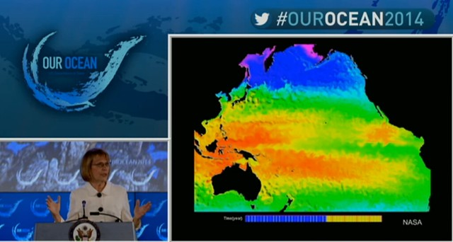 Director Leinen with sea-surface temperature graphic