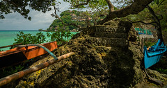 Welcome to Boracay (Skagos26) Tags: ocean travel blue sea orange beach nature water rock stone landscape boats island nikon asia southeastasia hill azure wideangle tokina huts engraving boracay resorts 1224mm philippeans d7100 puntabunga