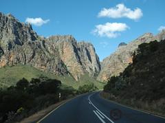 Straight Into The Mountains (jan-krux photography - thx for 1.1 Mio+ views) Tags: winter sky mountains landscape southafrica olympus berge roads landschaft felsen westerncape paarl suedafrika strassen drakenstein westkap r101 dutoitspass