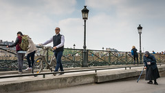 Disconnect (Ruth Flickr) Tags: city people woman man paris france bicycle river spring strangers beggar walkingstick disconnected passing lamps quai separate paris442