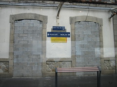 railroad station (Ladybadtiming) Tags: france building architecture bench dead grey roscoff bretagne gone quay morlaix walled obliterated stpoldelon